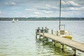 stock photo of jetties  - An old jetty at Starnberg Lake in Germany Bavaria Tutzing - JPG