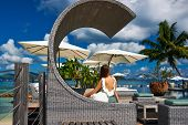 foto of jetties  - Woman on a tropical beach jetty at Seychelles - JPG