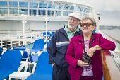 picture of passenger ship  - Happy Senior Couple Enjoying The View From Deck of a Luxury Passenger Cruise Ship - JPG
