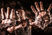 pic of future  - Brutal muscular dirty man expressing aggression over dark grunge background - JPG
