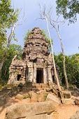 stock photo of hindu  - Hindu sanctuary situated name Ta Krabey stone castle under sunlight - JPG