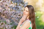 pic of orchard  - Beautiful young brunette woman in blooming orchard - JPG