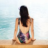 picture of swimsuit model  - beautiful long hair female model posing by the pool - JPG