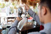 pic of draft  - Barman filling mug with draft beer - JPG