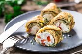 stock photo of curd  - Omelette rolls with curd and herbs on a plate - JPG