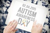 picture of autism  - Autism awareness day against hands touching tablet screen - JPG
