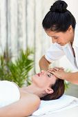 picture of forehead  - Brunette receiving forehead massage at the spa - JPG
