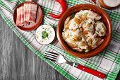 foto of fried onion  - Fried dumplings with onion and bacon in frying pan - JPG