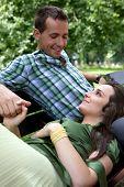 image of lap  - Girlfriend resting head on boyfriend - JPG