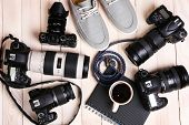 stock photo of megapixel  - Still life with modern cameras on wooden table - JPG