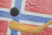 picture of hockey arena  - Hockey puck hockey stick and the image of the Norwegian flag on the ice - JPG