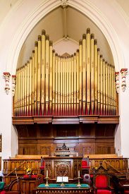 stock photo of organ  - Massive old pipe organ in a church in St John New Brunswick Canada - JPG
