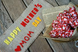 pic of i love you mom  - Happy mothers day with i love you mom message idea from colorful fabric starfish on wooden background beautiful flower abstract wooden texture mother - JPG