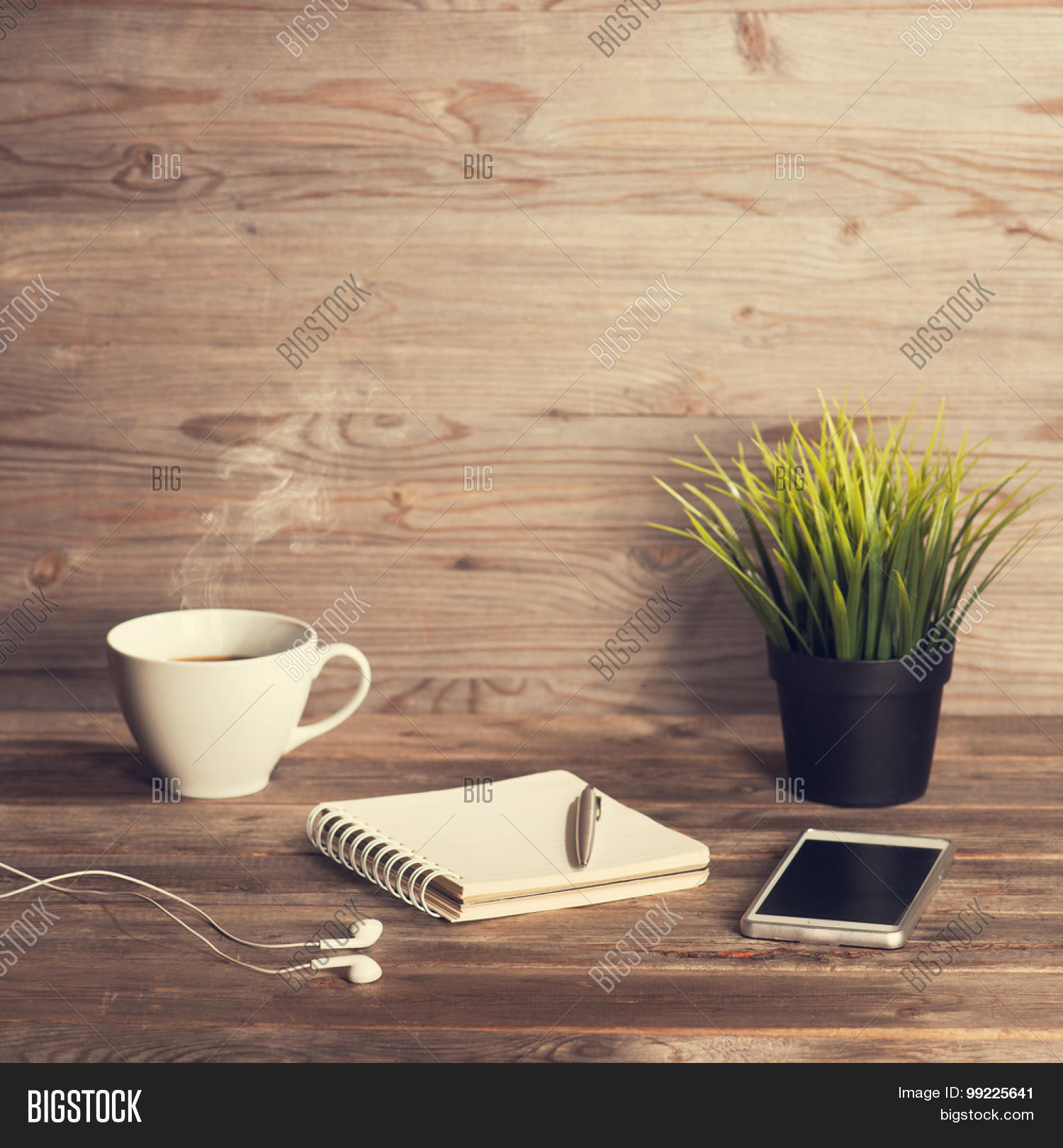 Working table notepad coffee cup image photo bigstock working table with notepad coffee cup pen smartphone headphone plant pot geotapseo Gallery