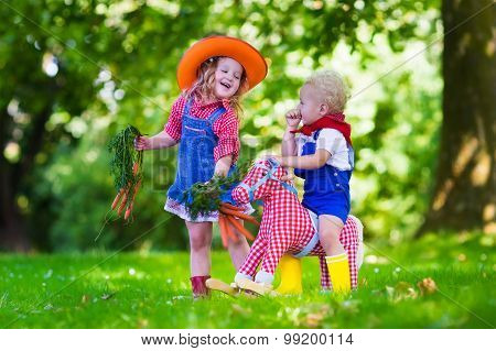 Cowboy Kids Playing With Toy Horse