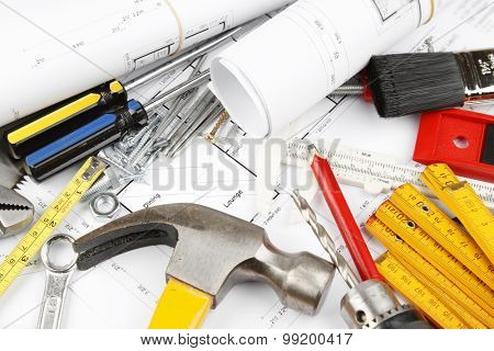Assorted work tools on building plans