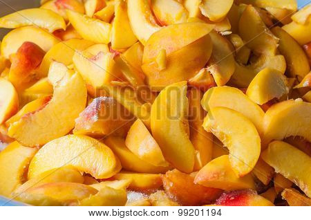 Sliced peaches in syrup. Cooking of peach jam or marmalade
