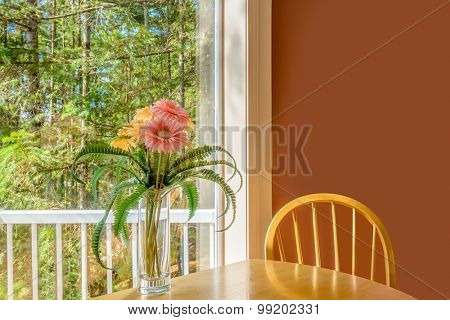 Table with flowers and a chair. Interior design of a luxury living room.