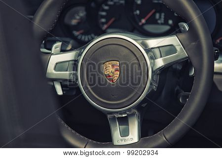 Sleza, Poland, August 15, 2015: Close Up On Porsche 911 Carrera S Car Steering Wheel And Cockpit  Mo