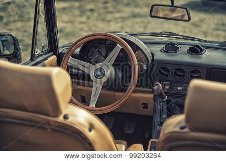 Sleza, Poland, August 15, 2015: Close Up On Old Vintage Steering Wheel And Cockpit Of Apha Romeo On