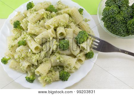 Pasta With Broccoli Served With Cooked Broccoli In A White Bow On A Wooden Table. Eating With Fork