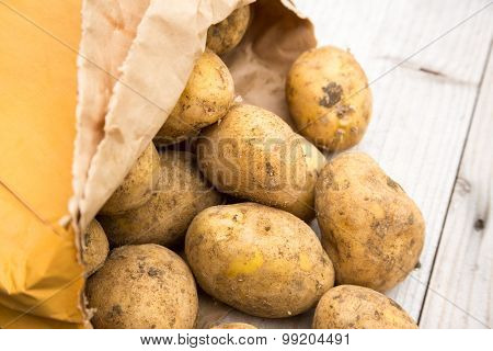 Bag of rustic dirty white potatoes