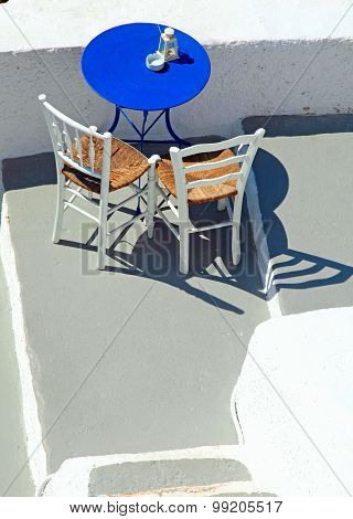 Blue Table And Chairs On Terrace In Oia, Santorini, Cyclades, Greece