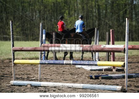 Unknown Riders On A Horse Jumping Training Summertime Outdoor