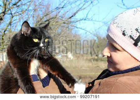 Woman Looking At Black Cat