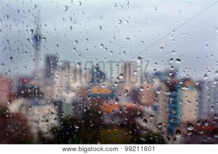 Rain Drops Falls On A Window Overlooking Auckland Cbd New Zealand