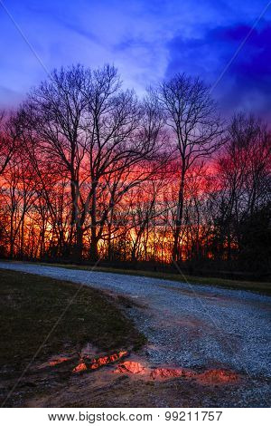 Sunset in Central Kentucky near Georgetown with gravel road in the foreground