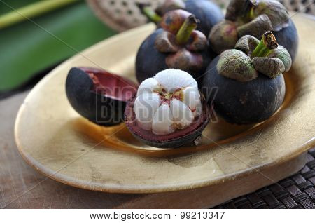 Mangosteen Fruit On Plate