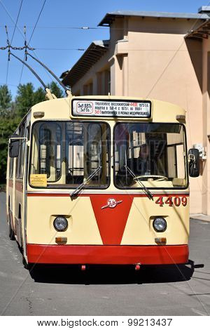 ST. PETERSBURG, RUSSIA - AUGUST 17, 2015: Driver in the old  trolley bus during the demonstration of the new cashless ticketing system supported MasterCard PayPass technology