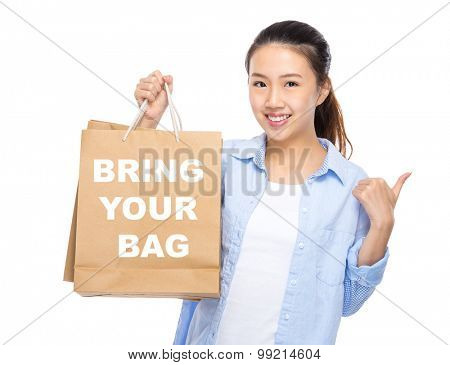 Woman with shopping bag and thumb up for showing bring your bag