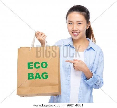 Asian woman finger point to shopping bag and showing eco bag