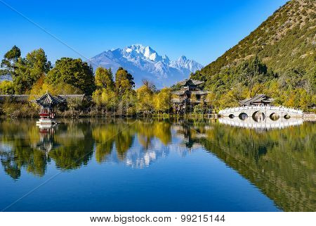 Reflection of Jade Dragon snow mountain on the lake in with  China