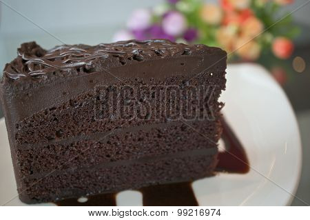 Piece Of Dark Chocolate Cake With Blur Flower