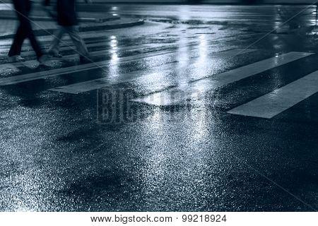 People Crossing Street In The Rain