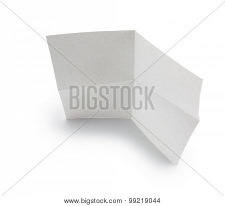 White sheet of paper standing, isolated on white. Focus on top edge.