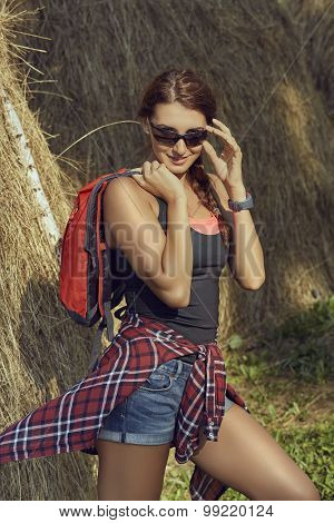 Tourist Woman With Backpack And Sunglasses