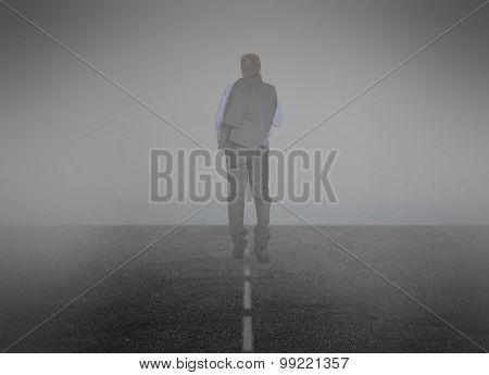 Smoke. Businessman goes into the mist