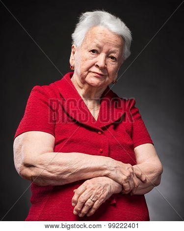 Portrait Of Pensive Old Woman