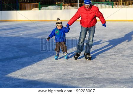 little boy skating with parent
