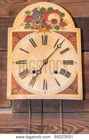 Vintage Kitchen Clock With Roman Numbers Hanged On Wooden Background