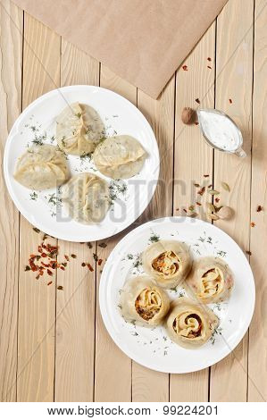 Traditional Georgian Khinkali Or Dumplings, Stuffed With Meat On Wooden Surface With Spices.