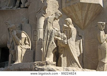BARCELONA, CATALONIA, SPAIN - AUGUST 29: Figures on Passion facade of Sagrada Familia Temple