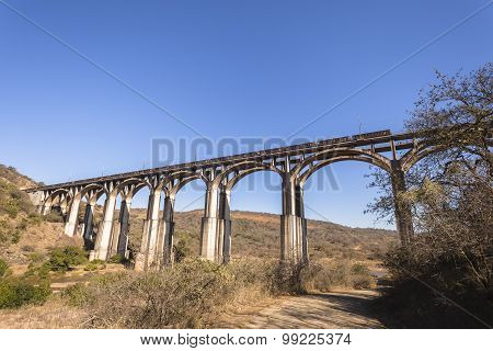 Bridge Train Rugged Landscape