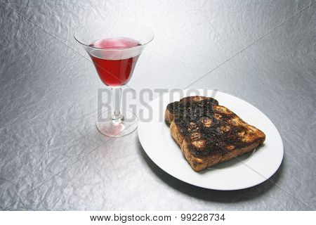 Drink In Wineglass And Raisin Toast