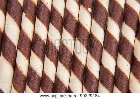 .chocolate Waffle Rolls With Chocolate Cream,selective Focus On White Paper Background