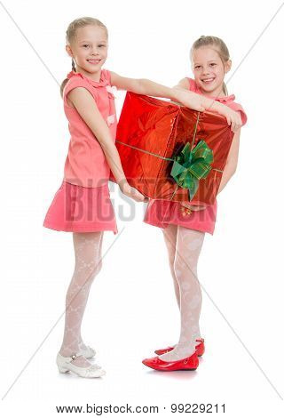 Two girls with big box